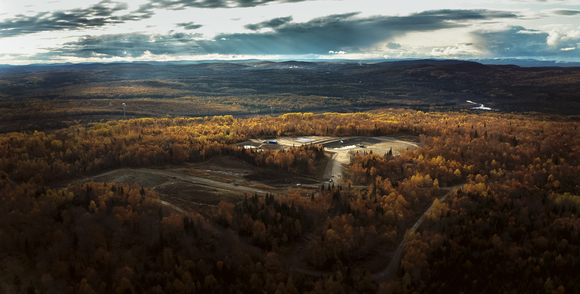 Photo of a mine seen from afar in an autumn landscape at the end of the day